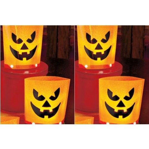 """Flickering LED Pumpkin Lanterns Halloween Pumpkin LED Lanterns - Set of four (4) -Flickering candle like effect - Battery Included - On/Off Switch - PVC Material - 6"""" x 5"""" x 3"""""""